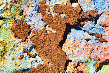 decomposing: Very rusty metal starting to decompose, colorful texture