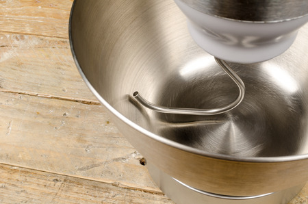 food processor: Steel bowl of a food processor with an attached dough hook