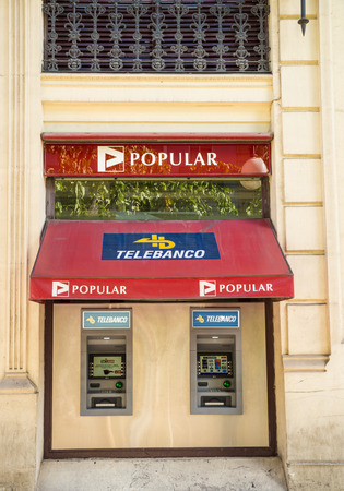 eurozone: MADRID, SPAIN - FEBRUARY 12, 2015: A Banco Popular branch. Popular  is one of the medium sized Spanish banks repeatedly seen struggling during the financial turmoil in the eurozone Editorial