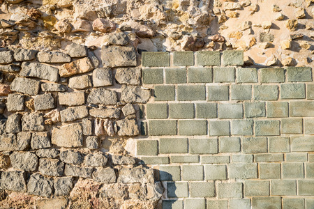 ���archeological site���: Rebuilt layers of an old wall on an archeological site Stock Photo