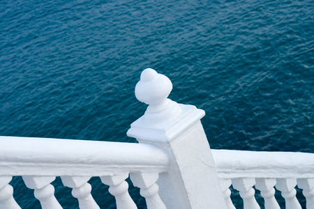bannister: White balustrade with ocean blue background, Mediterranean colors