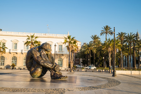 bombings: CARTAGENA, SPAIN - FEBRUARY 9, 2015: El Zulo statue by Victor Ochoa in Cartagena harbor.The statue is a tribute to victims of terrorism, in particular the ones of the 2003 Madrid train bombings. It shows a man in the attitude of a hostage