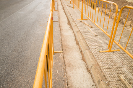 roadworks: Roadworks with a ditch for a pipeline protected by a barrier
