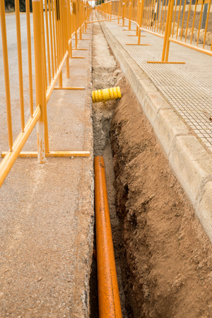 open trench: Roadworks with a ditch for a pipeline protected by a barrier