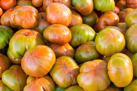 market stall: Full frame of fresh tomatoes on  market stall