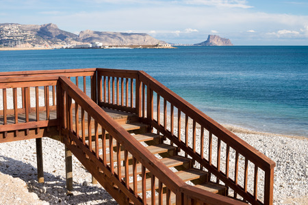 albir: Footbridge and steps to a sunny Mediterranean beach