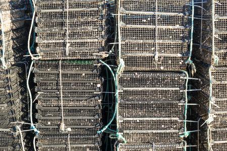 fish farming: Los montones de jaulas como utilizan para el cultivo de peces Foto de archivo