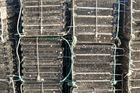 fish farming: Piles of cages as used for fish farming