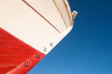 prow: Detail take of a ship prow with a depth gauge in Roman numbers Stock Photo