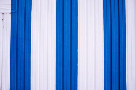 corrugated metal: A corrugated metal door painted in Mediterranean colors Stock Photo
