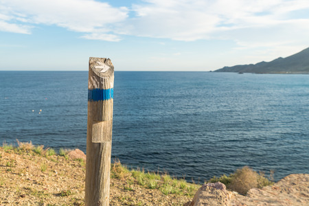 Wooden hiking guidepost against the background  of the coast Stock Photo