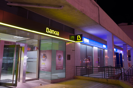 scandals: MADRID, SPAIN - FEBRUARY 24, 2015: A Bankia branch. Bankia was the result of a merger of several failed savings banks and has been in the eye of several political scandals since.