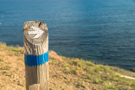 guidepost: Wooden hiking guidepost against the background  of the coast Stock Photo