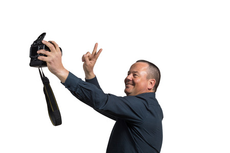 midlife: Guy in his 40s fooling around with too big a camera for a selfie Stock Photo