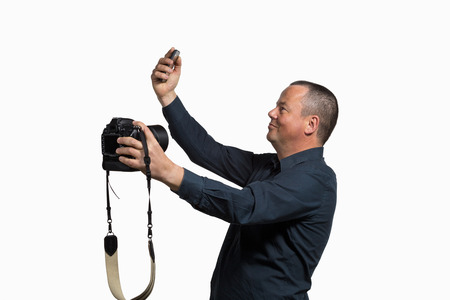 narcissistic: Guy making a fool of himself shooting a selfie with multiple cameras