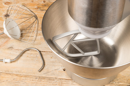 food processor: Food processor with different accessories on a rustic kitchen table