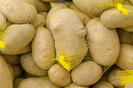 market stall: Fresh potatoes in nets on a market stall