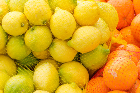 market stall: Oranges and lemons in nets on a market stall