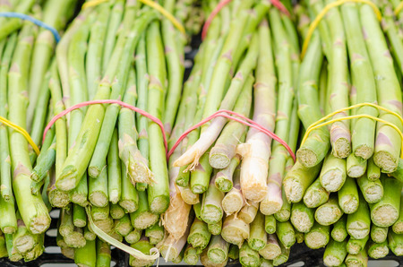 bundles: Bundles of green asparagus on a street market