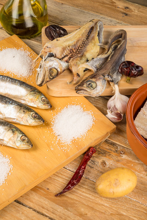 Assorted salt cured fish with ingredients for Mediterranean recipies photo