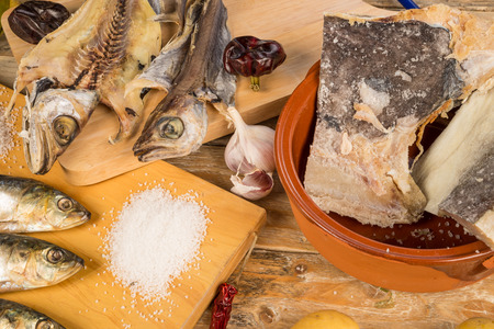 cured: Assorted salt cured fish with ingredients for Mediterranean recipies