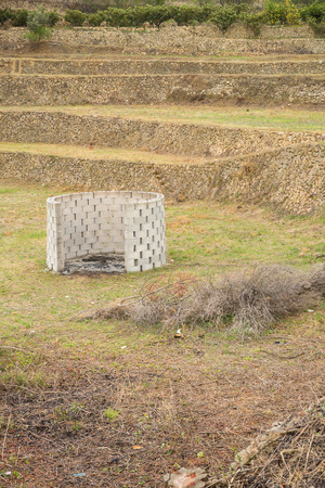 terraced field: Burner for pruning waste amidst a terraced  field
