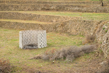 waste prevention: Burner for pruning waste amidst a terraced  field
