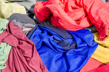 market stall: Asssortd clothes on display on a jumble sale market stall