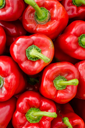 red peppers: Full frame take of red peppers on a market stall