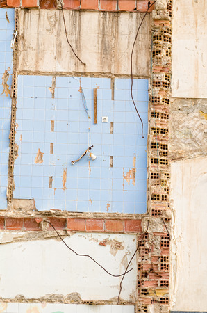 botched: Patches of tiles and bricks left on a demolished wall