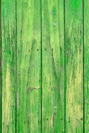 strongly: Full frame take of strongly weathered green wooden  planks