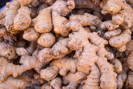 market stall: A heap of fresh ginger roots on a street market stall