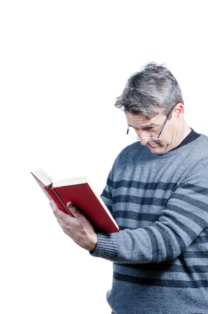 quite: Guy finding holding a book at quite a distance to be able to read