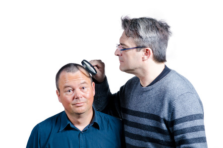 detecting: Guy inspecting another guys hair and detecting hair loss