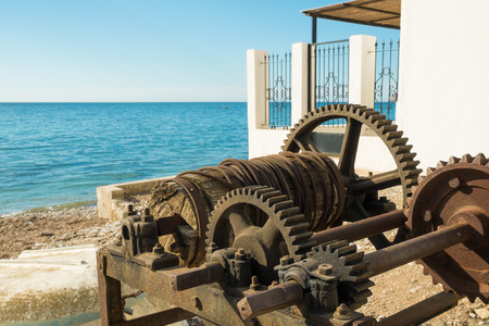 winch: Old winch as used to tow fishing boats ashore Stock Photo