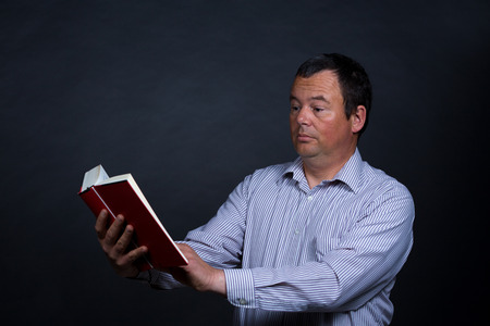 increasingly: Man finding it increasingly difficult to read without glasses
