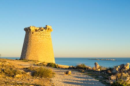 costa blanca: Old  watchtower on the Mediterranean coast, Costa Blanca,  Spain Stock Photo