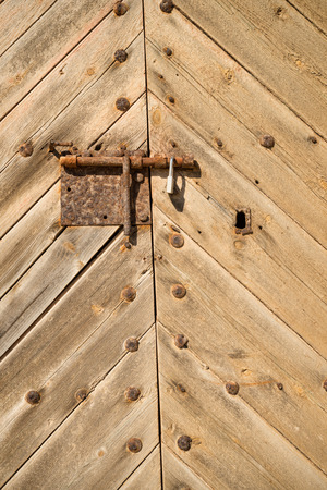 door bolt: Full frame take of an old door with a rusty bolt