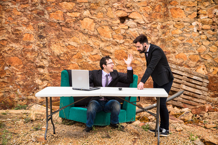 ensuing: Argument ensuing in a grunge office, a business concept Stock Photo