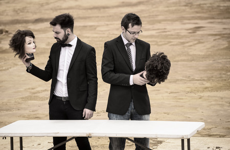 beheaded: Two guys holding mannequin heads in Shakespearian fashion
