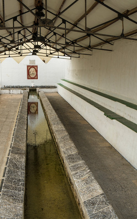 washhouse: Interior of a traditional washhouse still in use Editorial