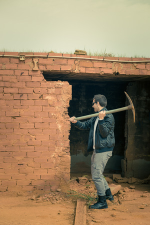 knocking: Guy knocking down a wall using a pickaxe