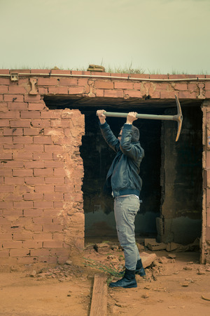 pickaxe: Guy knocking down a wall using a pickaxe