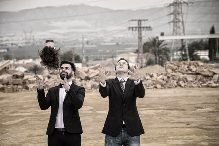 terrify: Two guys playing with mannequin heads in a gloomy setting Stock Photo