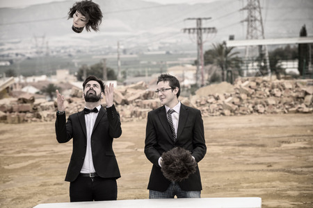 beheaded: Two guys playing with mannequin heads in a gloomy setting Stock Photo