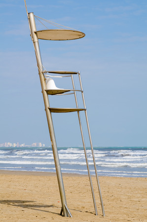 resort beach: Lifeguard seat on a sandy Mediterranean resort beach Stock Photo