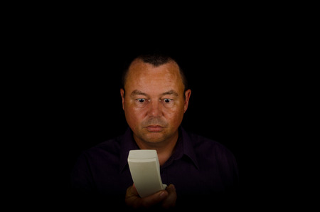 baffled: Man with an incredulous expression while holding a handset