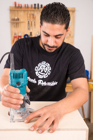 making music: Milling machine being used to craft a cajon flamenco percussion instrument Editorial
