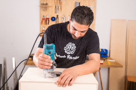 milling machine: Milling machine being used to craft a cajon flamenco percussion instrument Editorial