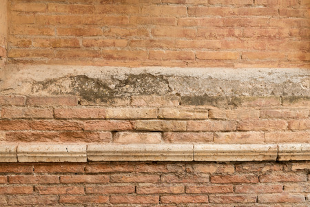 red clay: Old weathered wall made of red clay bricks